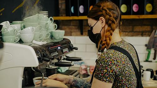 Abi making a coffee using the barista machine